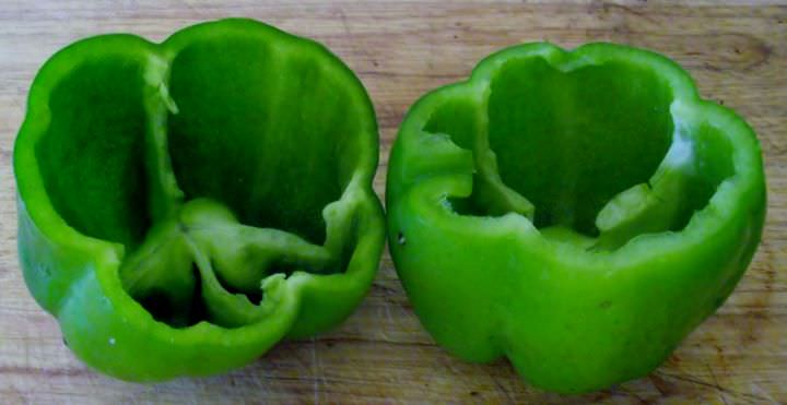 Bell peppers with tops cut off.