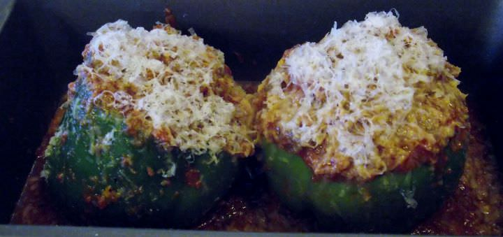Brown rice stuffed bell pepper recipe with mushroom, onion, garlic, and Pecorion Romano.