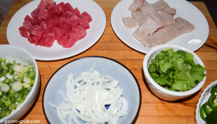 Ingredients for sashimi and poke: ahi tuna, mahi mahi, green onions, white onion, cilantro, and jalapeño peppers.