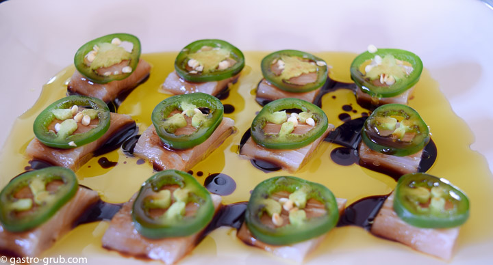 Mahi mahi sashimi with jalapeno peppers, olive oil and soy sauce.
