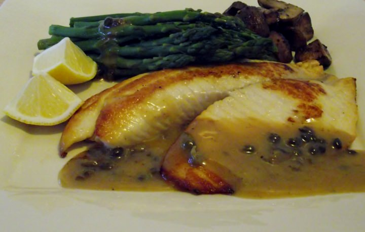 Pan fried tilapia, asparagus, and sauteed mushrooms.