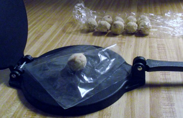 Tortilla press with masa ball
