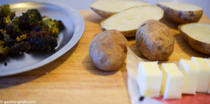 Ingredients for twice baked potatoes: baked potatoes, roasted broccoli, and butter.