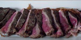 Rare NY steak sliced on a bias.