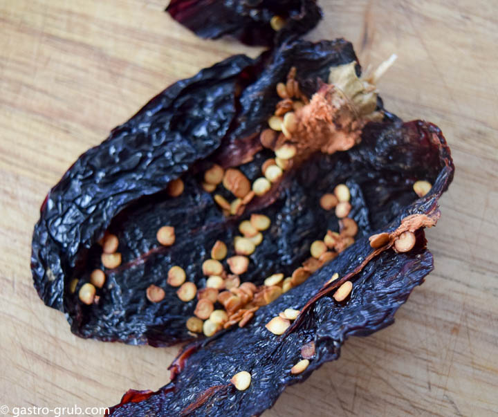 The ancho chili opened up exposing the seeds.