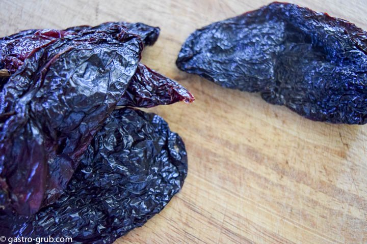 Ancho chilies on a cutting board.