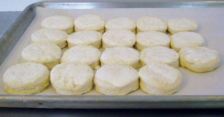 Roll the biscuits out and arrange on a sheet pan, just slightly touching.