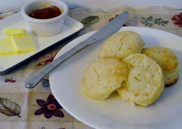 Buttermilk biscuits, apricot jam, and butter.