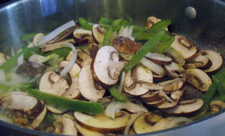 Sauteing mushrooms, onions, and peppers.