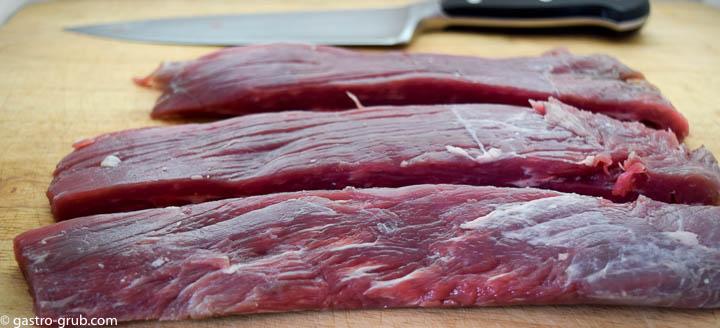 Flank steak cut into strips.