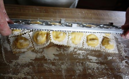 Dumping out ravioli mould.